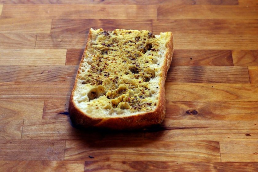 Piece of sliced bread on a wooden countertop