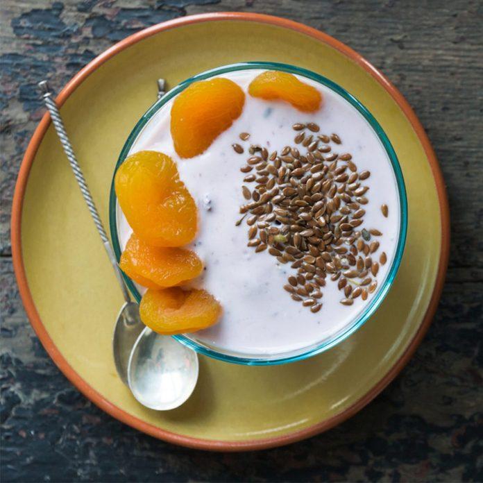 yogurt bowl with fruit and flaxseed