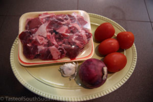 Pictured above are Lamb meat, tomatoes, onions, garlic, ingredients for lamb stew.