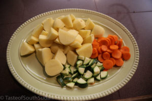 Pictured above are Potatoes, carrots and zucchini cut ready for lamb stew