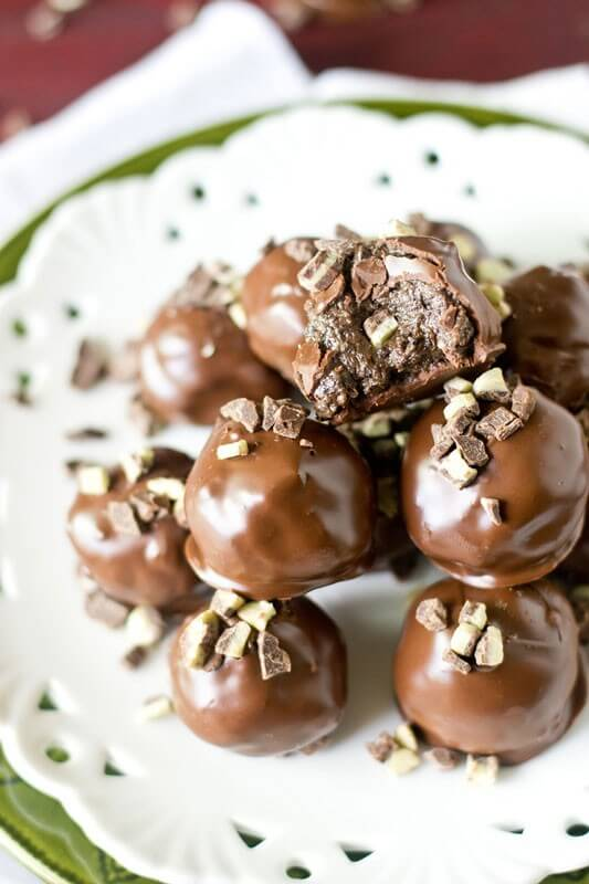 Mint Oreo Truffles stuffed with peppermint patties and Andes mints. Oreo balls with a twist!