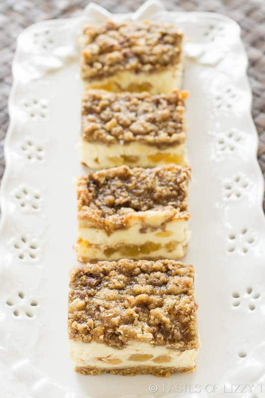 pretty white dessert plate holding homemade apple cheesecake bars