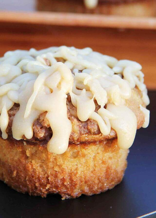 fluffy Caramel Apple Buttermilk Muffin topped with sweet icing