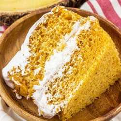 pumpkin angel food cake with cool whip in the center