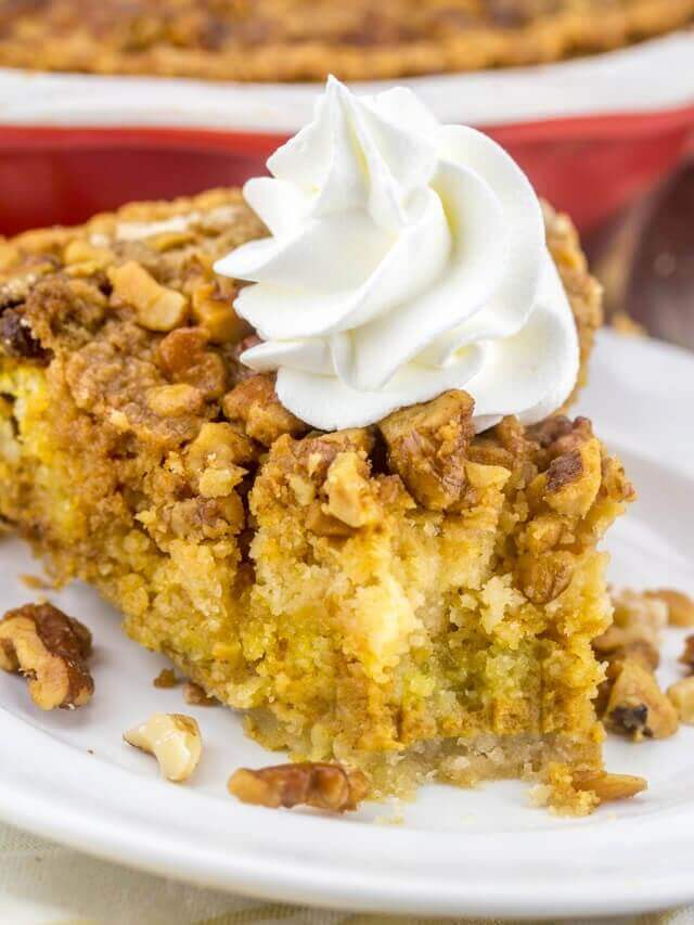 slice of pumpkin crumb pie with whipped cream on top