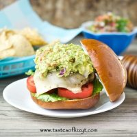 If you love guacamole, you'll love these Mexican Guacamole Burgers. They've got Mexican seasoning baked inside and homemade guacamole on top!
