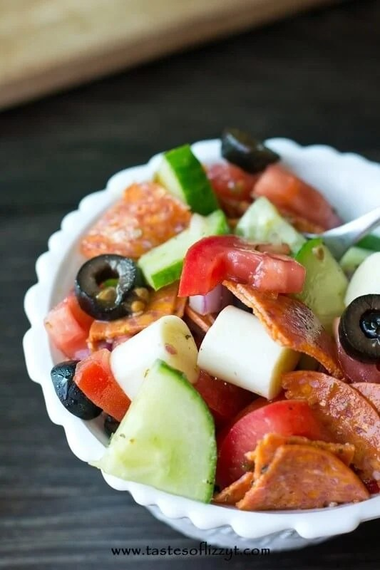 Smoked Mozzarella Tomato Salad is a quick and easy healthy side dish to complement your summer picnics. You'll love the combination of pepperoni, garlic, red onion, red wine vinegar and smoked mozzarella that creates a salad full of flavor!