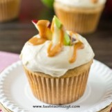 caramel apple cupcakes topped with caramel and apple slices