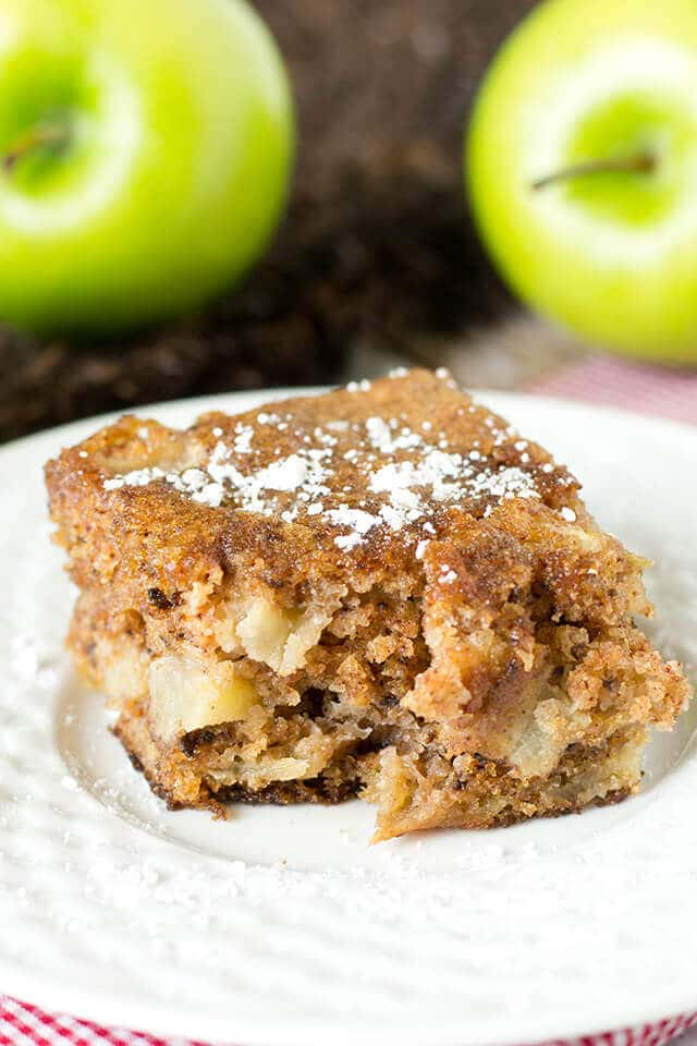slice of moist cinnamon snack cake with apples and walnuts