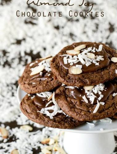 Bake these Almond Joy Chocolate Cookies for the coconut lover in your life. The cookies are fudgy with chopped Mounds bars inside and chocolate, coconut and almonds on top.