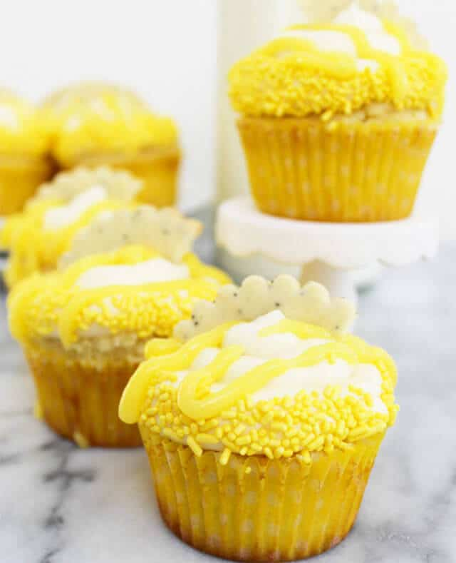 Fresh Lemon Cupcakes: These light and fluffy lemon scented cupcakes are filled with bright, tart lemon curd and topped with a rich, creamy vanilla frosting.