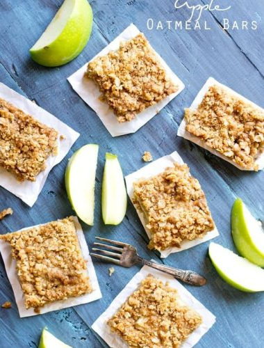 apple oatmeal bars surrounded by fresh green apple slices