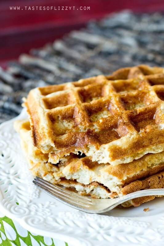 a stack of sweet apple waffles topped with cinnamon apple syrup