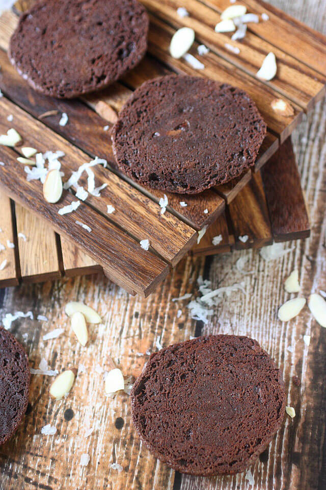 A Sweet coconut and almond filling is sandwiched between two soft baked brownie cookies. If there is ever a cookie you need to try – These Almond Joy Brownie Sandwich Cookies are the one!