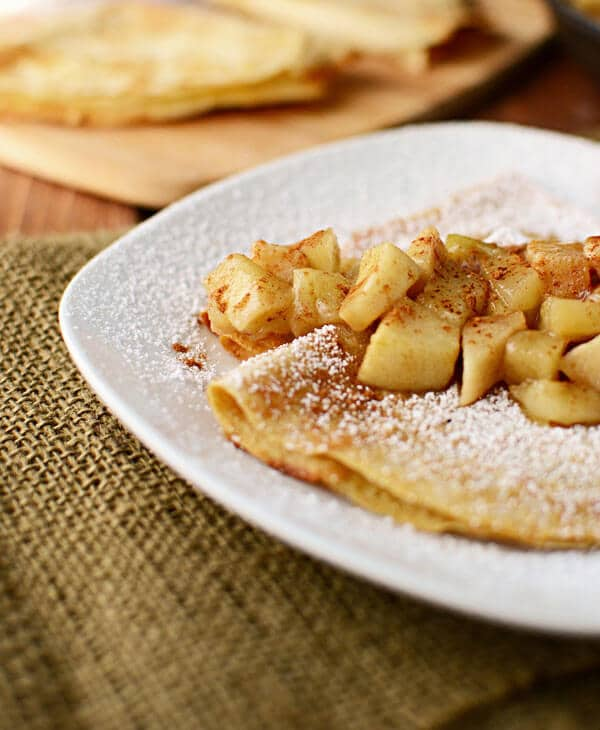 Apple pie crepes stuffed with vanilla yogurt crepe filling and topped with apple pie filling