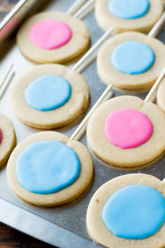 A simple decorated sugar cookie recipe is the star of the party with these Gender Reveal Cookies! Will it be pink or blue?