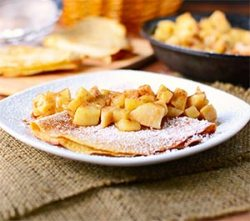 Whole wheat apple pie crepes stuffed with vanilla yogurt and topped with apple pie filling.