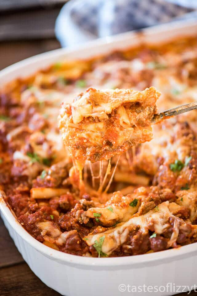 This easy baked ziti recipe is a layered Italian casserole full of noodles, ground beef and creamy cheese. It makes a large casserole and is great for leftovers!