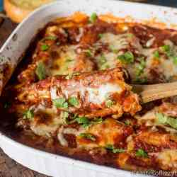 A simple cheese filling and rich, hearty spaghetti sauce make this three cheese manicotti a comforting family dinner. Serve with a side salad and garlic bread.