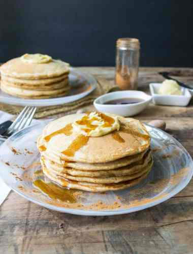 Whole wheat cinnamon pancakes that are light and fluffy. Maple butter makes the perfect topping for this fall breakfast!