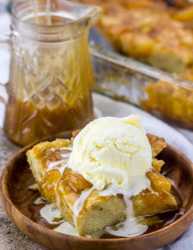 dish of Caramel Apple Bread Pudding topped with a scoop of vanilla ice cream