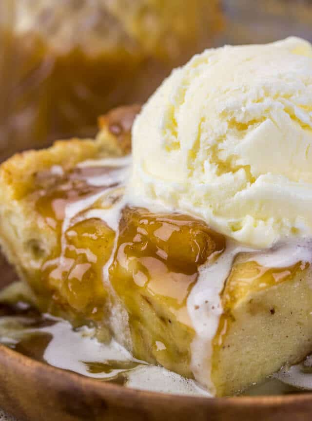 slice of caramel apple bread pudding topped with ice cream