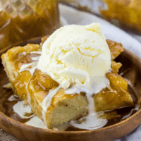 caramel apple bread pudding topped with vanilla ice cream