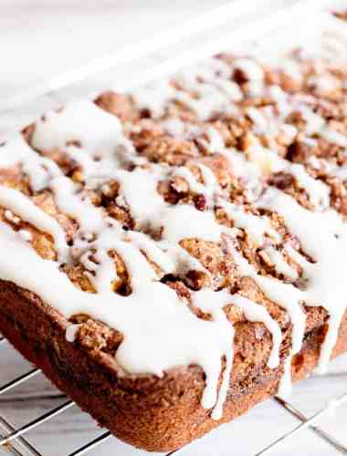 loaf of apple fritter bread with glaze