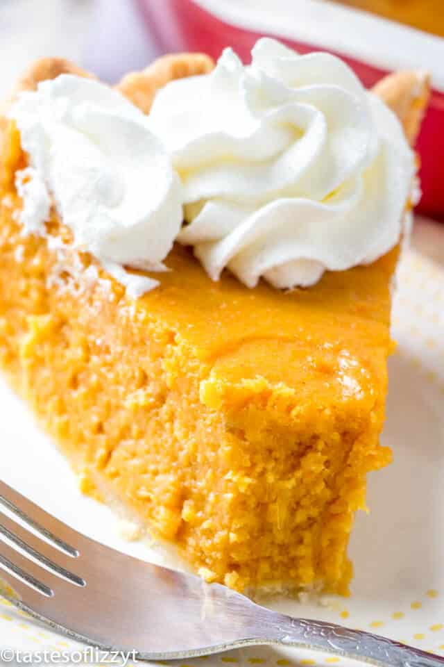 slice of sweet potato pie with whipped cream on top