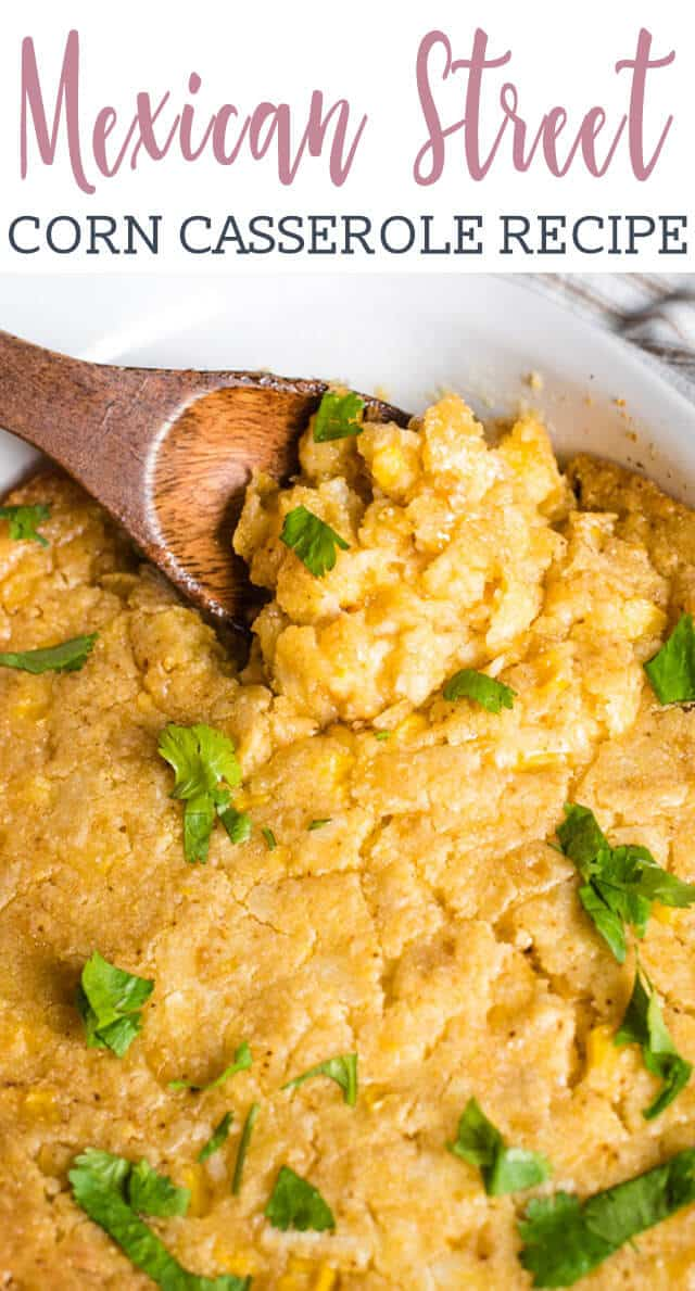 Mexican Street Corn Casserole with a wooden spoon