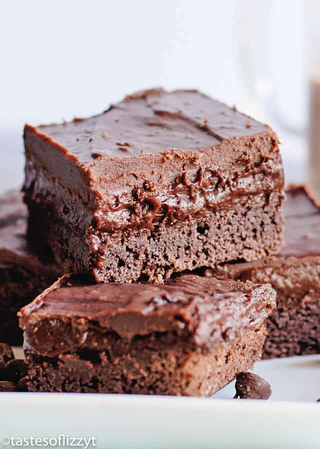 chocolate cake mix brownies topped with chocolate pudding and chocolate glaze