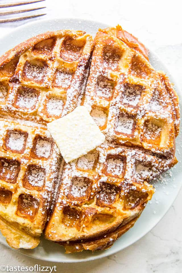 overhead shot of French Toast Waffles with powdered sugar on a plate