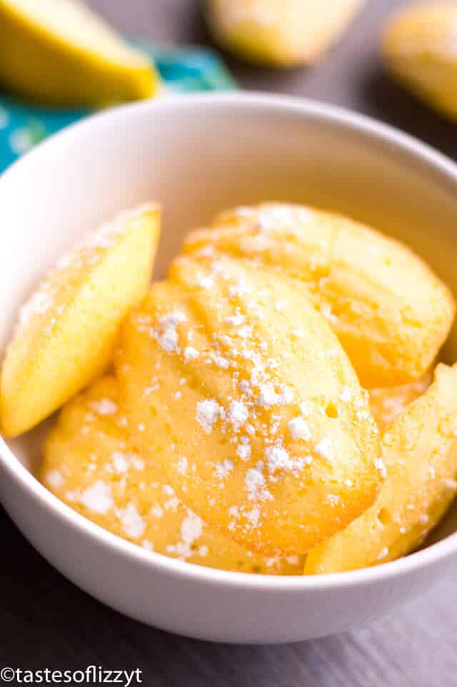 lemon madeleines dusted with powdered sugar