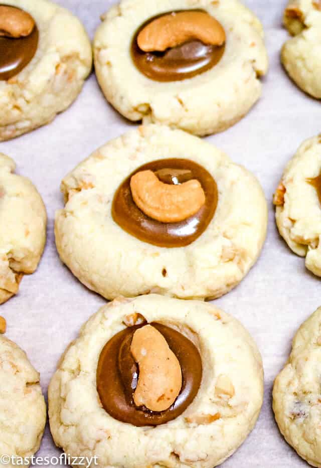 Christmas thumbprint cookies with brown sugar filling and cashews