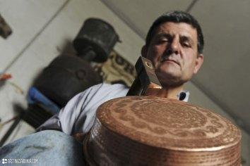 coppersmith Luigi Pitzalis working in his own workshop