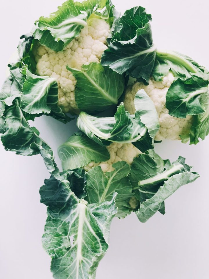 green and white vegetable on white surface