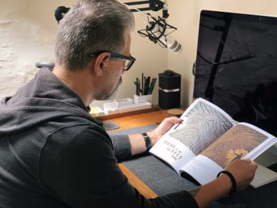 Andy Clarke reading Pressing Matters magazine