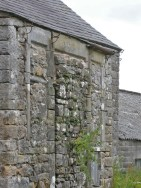 Puzzling features in the south wall of what is now the barn