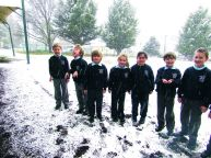 Students lap up the snow.