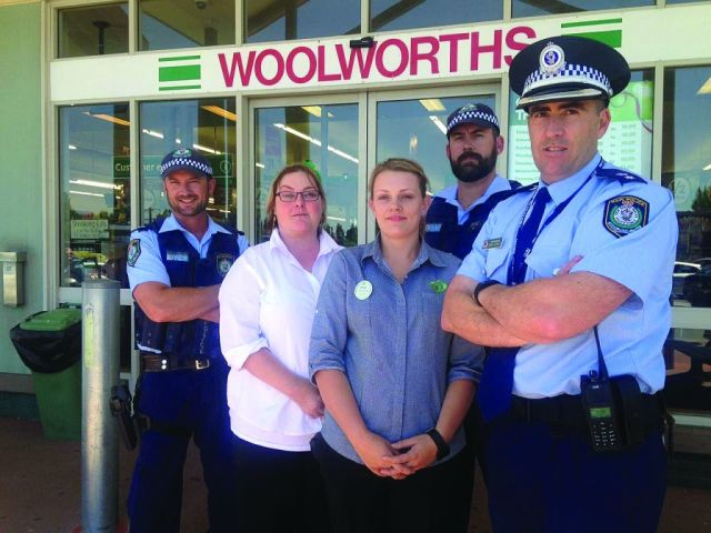 Sergeant Constable Matthew Goode, retailers Kirsty Harris and Fiona  McDougall, Senior Constable Todd Chapman, and Superintendent Christopher Schilt.