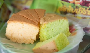 The sponge cakes of Trang come in many colours and flavours including orange, coffee, pandan and butter, and a famous three flavour cake.