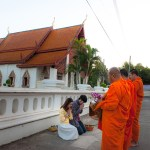 Giving alms to monks at Hua Khuang Temple, Nan