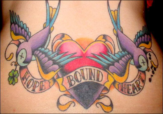 The Miami Ink pair of flying birds tattoo for girls.
