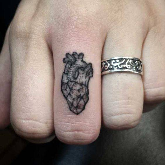 tattoo on finger with the heart