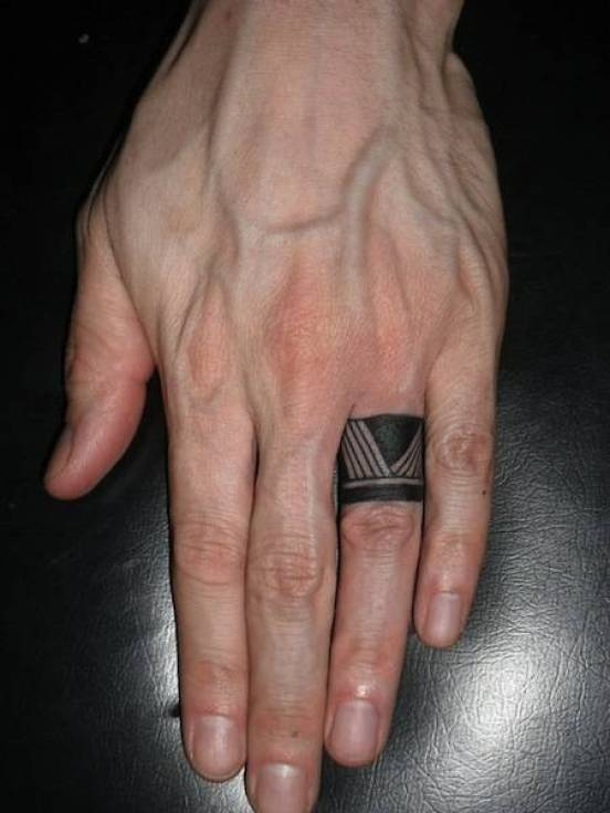 Tribal tattoo on the finger of the guy - ring