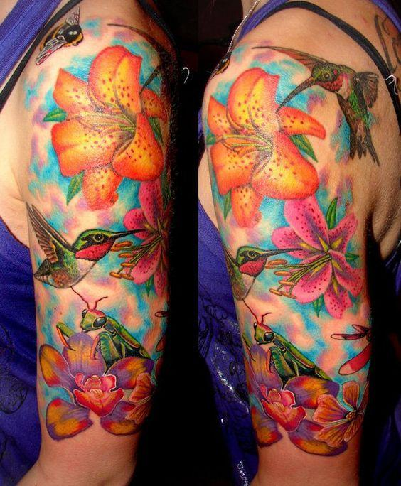 Tattoo sleeves on a female hand with a lily and a hummingbird