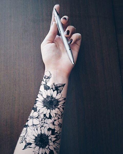 Tattoo sleeves on a female hand