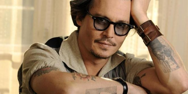 Johnny Depp's arms are covered with different tattooes - nearly half sleeves