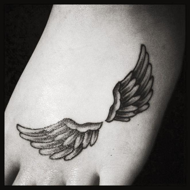 Accurate small angel wings tattoo looks stunning on foot