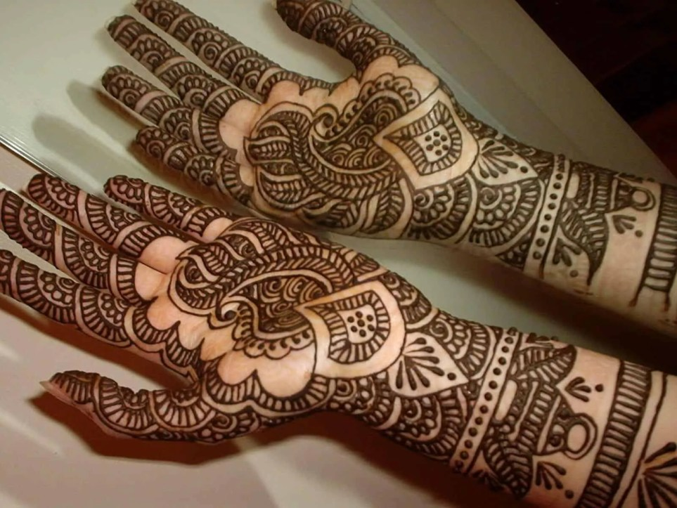 Henna temporary tattoo design on arms